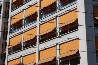 A building with orange sun screens