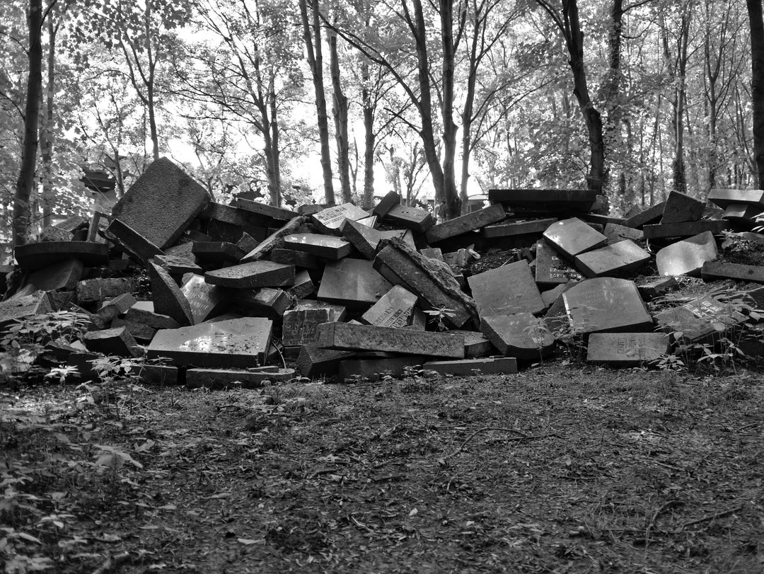 tomb stones broken down and stacked up
