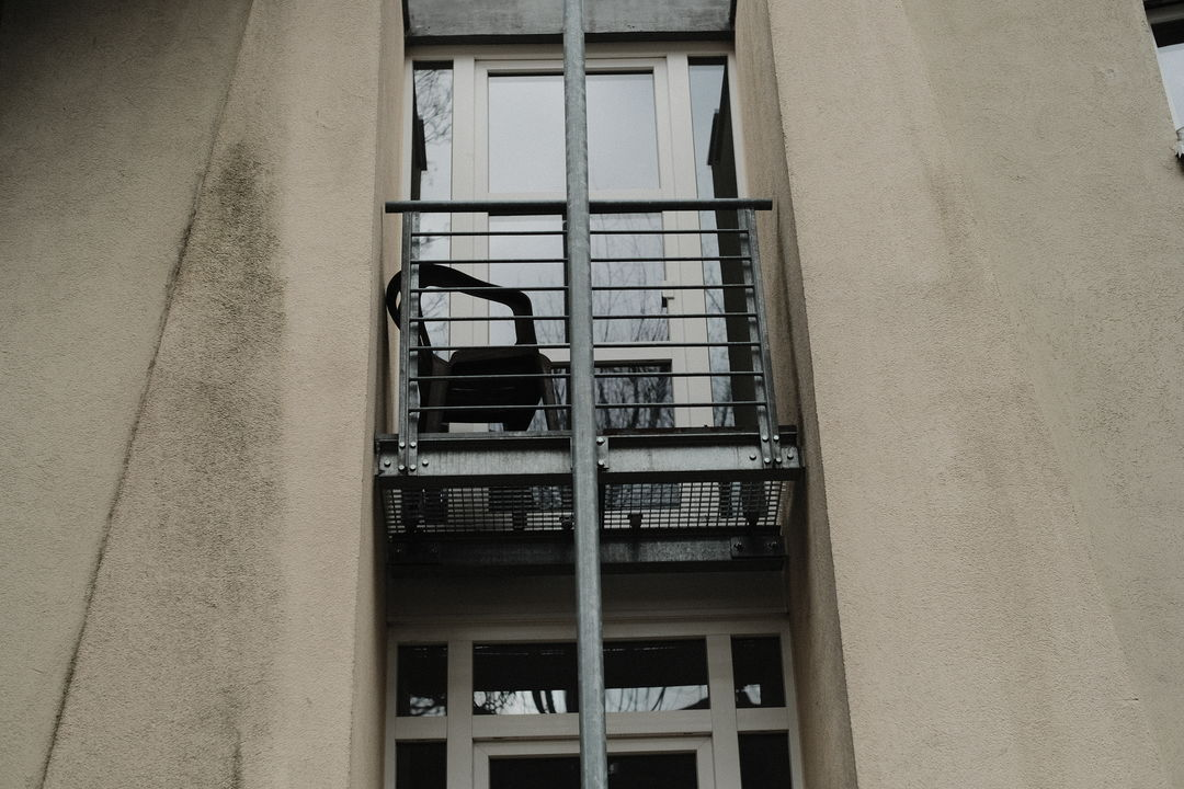 Balcony with plastic chair