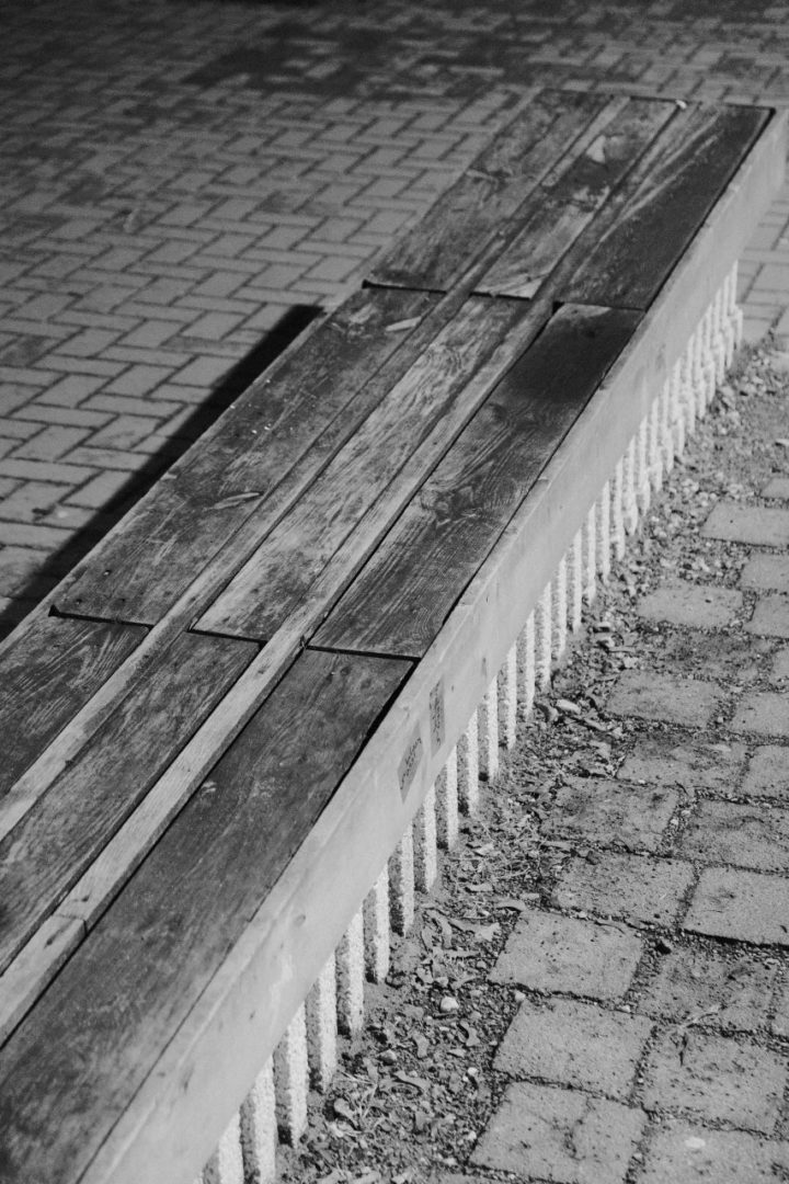 a concrete bench with wood panels