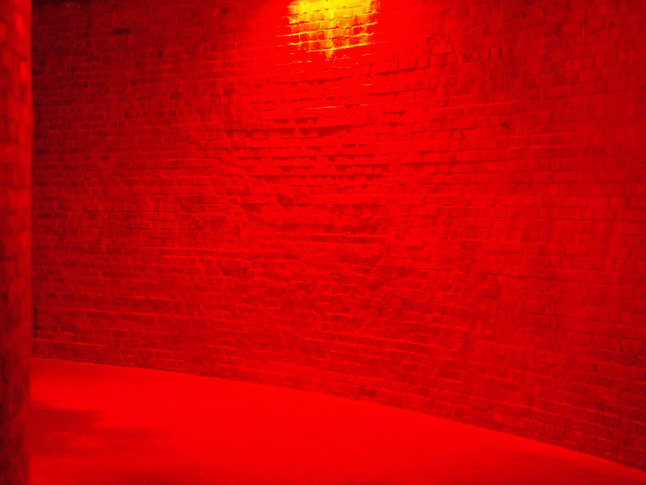 a corridor lit with red light