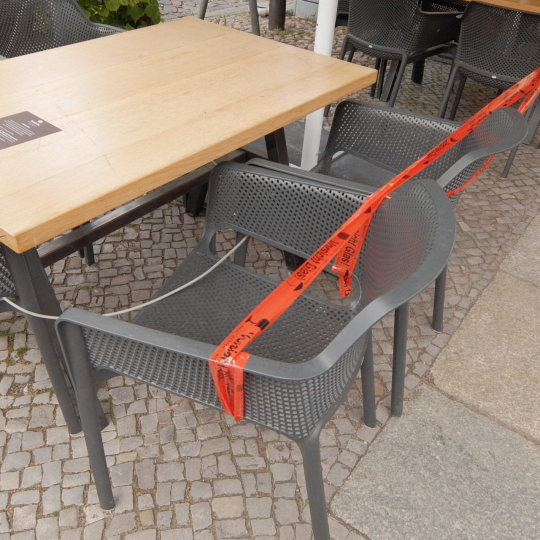 tables, chairs and barrier tape