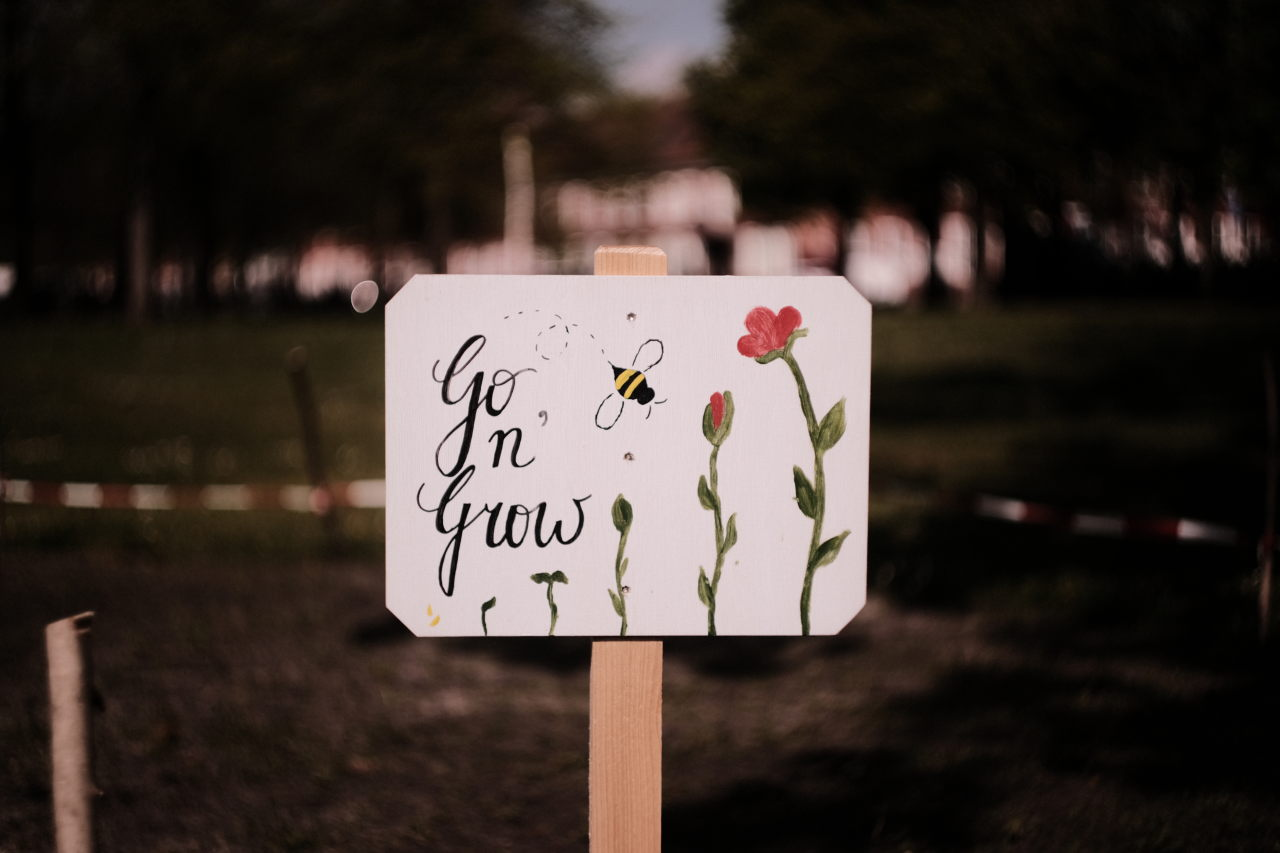 a sign with flowers